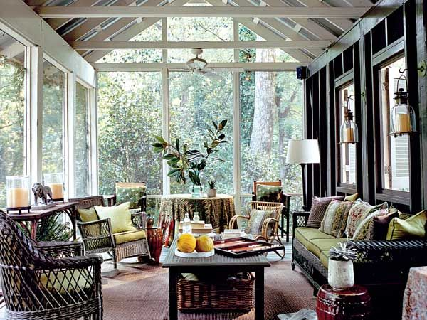 Layers of richly patterned fabrics make this screened porch feel like an interior room. Extra seating pushed against the back walls lets the room accommodate a crowd without looking crowded. (Photo: Megan Thompson)