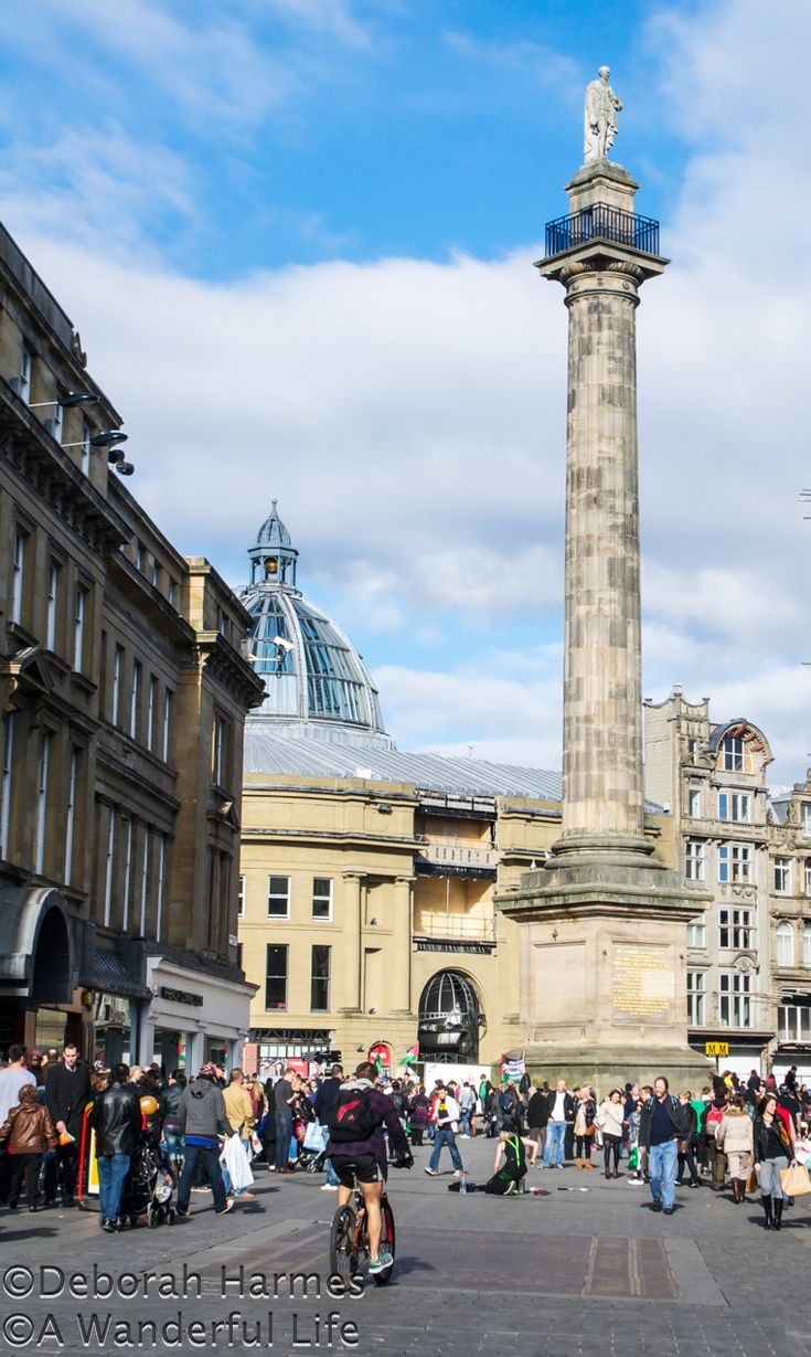 Saturday shopping on a sunny day in Newcastle Upon Tyne, UK, from Grainger St., showing Earl Grey's Monument.