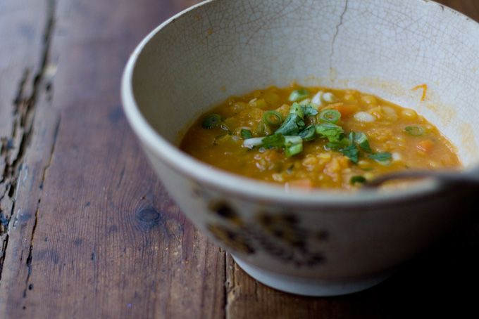 Inspired by an Ayurvedic dal recipe in the Esalen Cookbook, this is a light-bodied, curry-spiced coconut broth thickened with cooked red lentils and structured with yellow split peas. The back notes of ginger, slivered green onions sauteed in butter, and curry-plumped raisins make this a new favorite of mine.