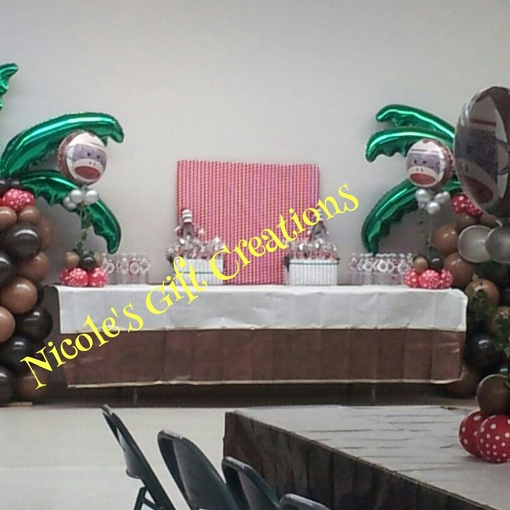 Sock monkey baby shower palm tree balloon columns centerpieces bottled water favors - Monkey balloons for baby shower ...