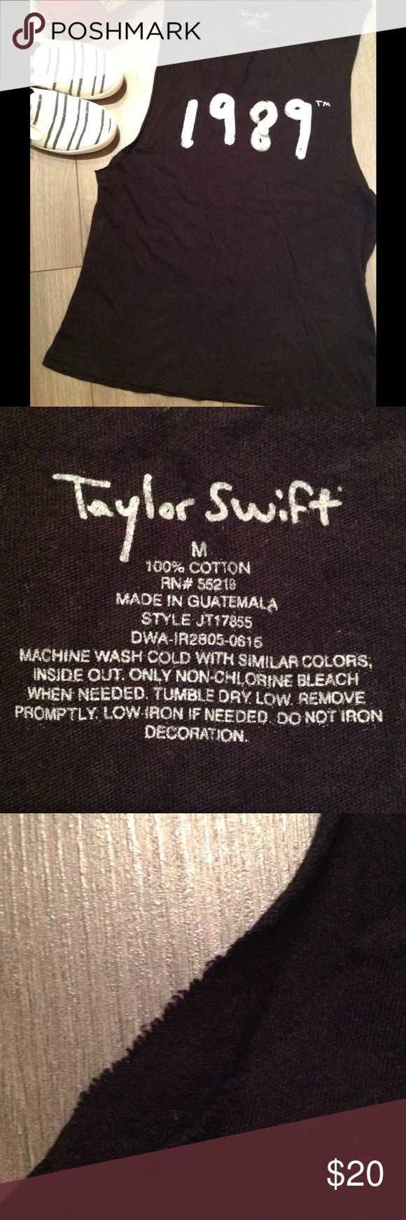 NWOT == Taylor Swift 1989 Sleeveless Tee Brand New Without Tags = Taylor Swift 1989 Official Merchandise Vintage Style Muscle Tee. Super soft and 100% cotton. Super cute vintage style torn sleeveless arms. I went to the concert, bought the tee shirt but never wore it. Tops Tank Tops