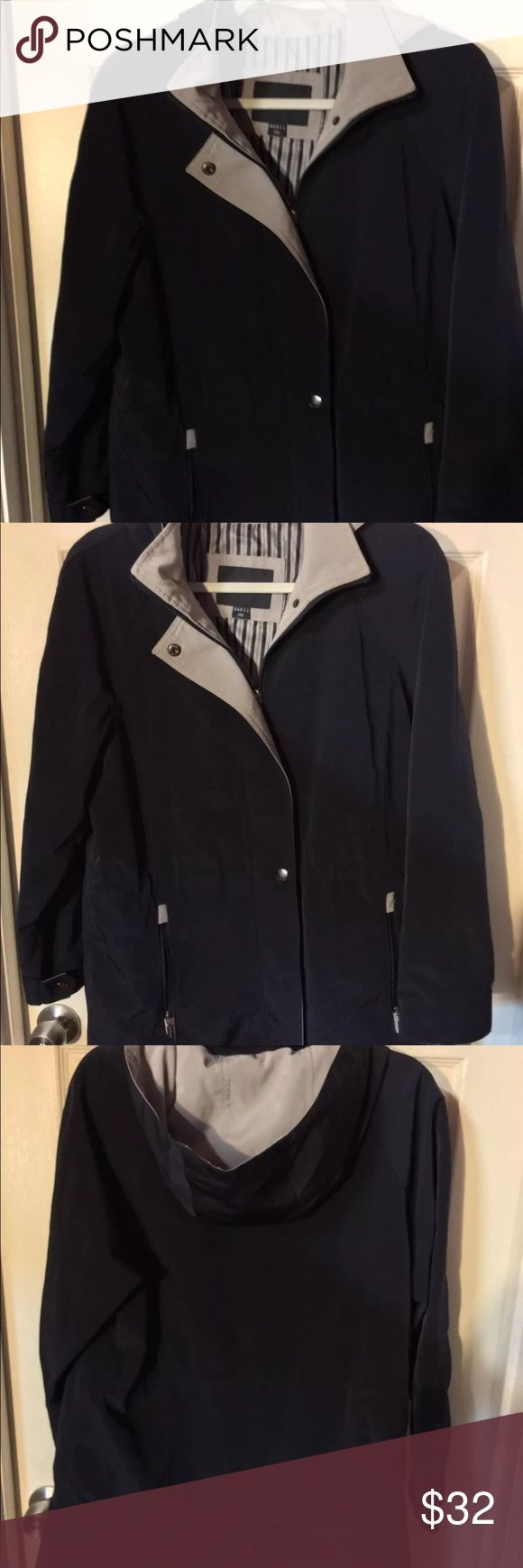 Nautica Woman's coat size M Preowned woman's Nautica jacket coat size M in excellent condition navy blue and taupe gray. Has two exterior pockets, hood zipper closure and snap closure also has ties for cinch waist Nautica Jackets & Coats