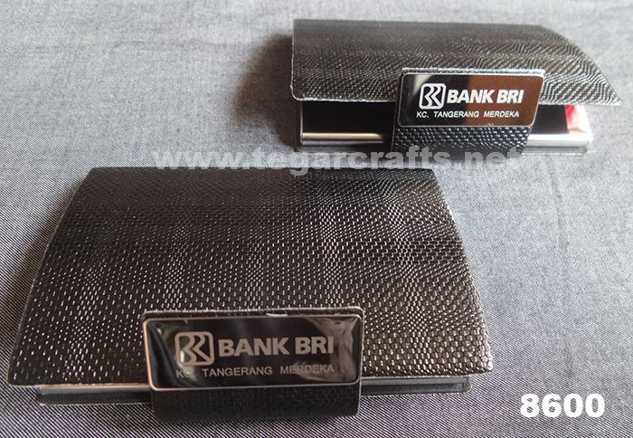 8600: A Business Card Holder for an exclusive souvenir ordered by BPJS Kesehatan and BRI, Bank Rakyat Indonesia. Rough texture similar to leather snake with separate opener of the lid. The right choice to serve as a banks souvenir or government agencies. Ideal also to serve as the exclusive merchandise. To be given to customer when you visited them.
