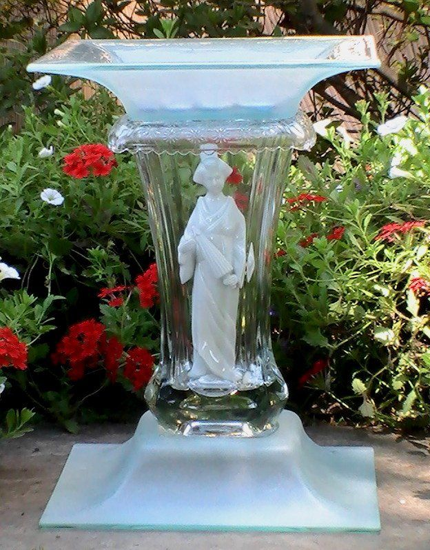 Glass Garden Bird Bath Feeder Asian Crystal Mariko Geisha  This item is no longer available but kept as a sample of ones I have done.  The name of this piece is Mariko. It includes 5 pieces of glass, accented with a Geisha inside a heavy crystal center section and square sea foam green top and bottom. It stands approximately 14 inches high.