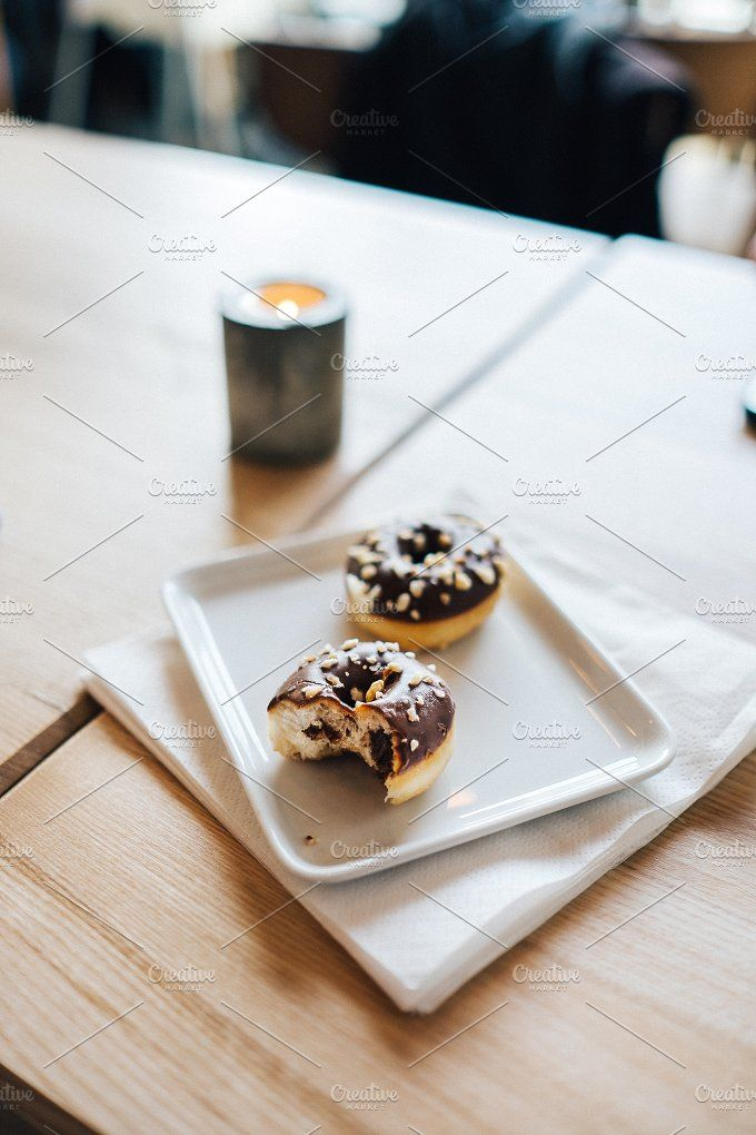Small chocolate donuts by Borishots on @creativemarket
