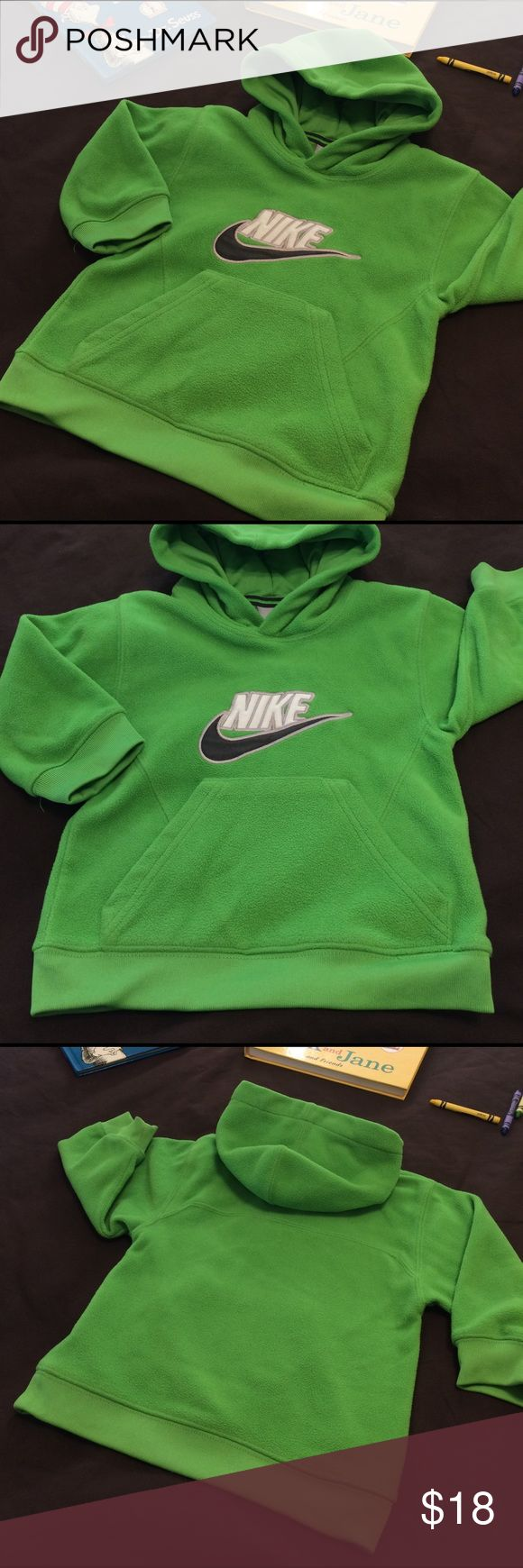 Nike Fleece Hoodie Pullover EUC bright green Nike fleece hoodie pullover top. White logo embroidered Nike on front with Olive green signature Swoosh. Perfect to toss on after practice or the big game. Also great to have on hand when you just want a warm layer. Tag says 2T but should fit to 3T since it's the same size as other 3T pieces. Nike Shirts & Tops