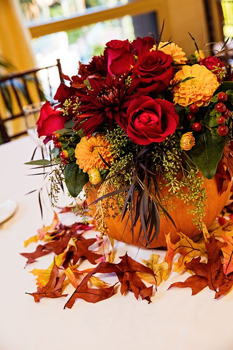 add a hint of halloween to your wedding reception with pumpkin floral centerpieces - Halloween Wedding Centerpieces