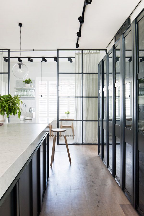 THE GLASS DIVIDE: A SELECTION OF KITCHENS BEHIND GLASS