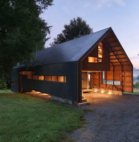 i actually like this modern twist on a barn. simple construction, awesome lighting
