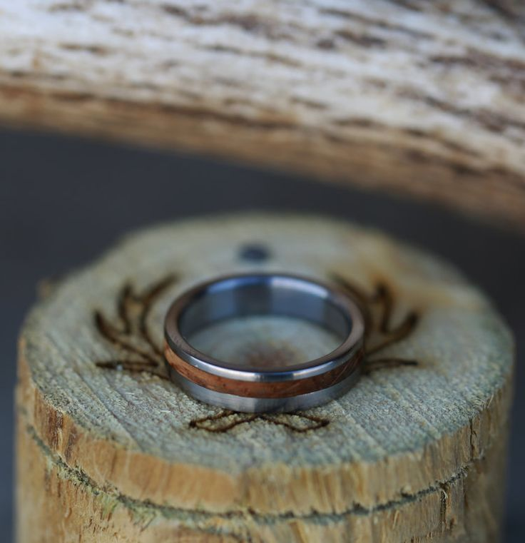 Whiskey barrel inlay on titanium wedding band. Handcrafted by Staghead Designs.