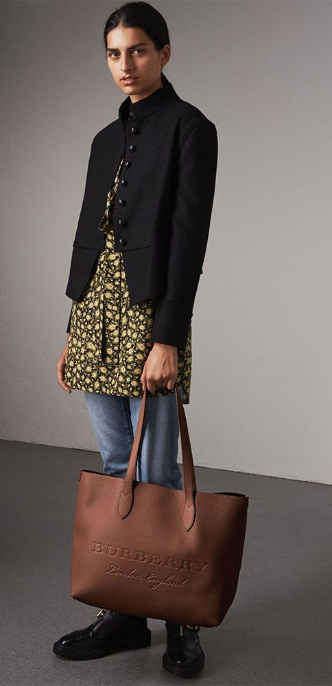 2ce0807cc45 A versatile tote by Burberry in soft textured calf leather with an interior  zip pocket for small essentials. The minimalist design is finished with  embossed ...
