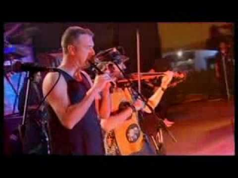 Mago De Oz - Fiesta Pagana.  Spanish folk metal.  I've no idea what the words mean, or what the guy in the emm.. mascot suit is doing, but the shot at 3:20 with 3 guitars and an accordion rockin' out is enough for me :)