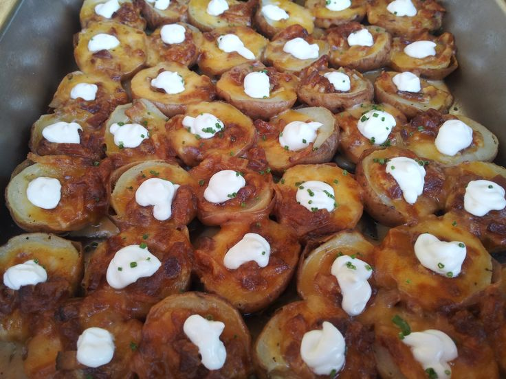 Stuffed Red Bud Potato Skins with Apple Wood Smoked Bacon, Cheddar Cheese, Sour Cream, and Chives #potatoskins #food #catering #bacon #sourcream #potato #cheese #foodpics #foodlover #comfortfood #delicious #bitesize #goodeats