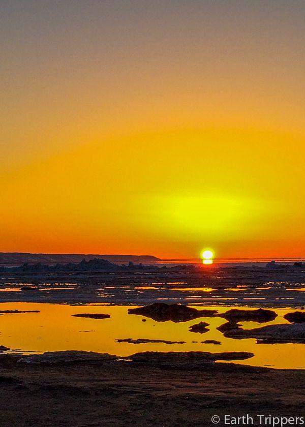 Big orange sunset skies at Wasaga Beach as winter ends.