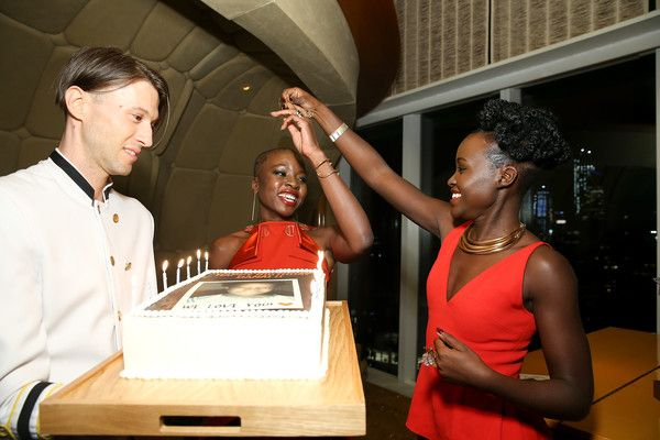 Actress Danai Gurira blows out the candles on her birthday cake as Lupita Nyong'o looks on during the DANAI x One x Love Our Girls celebration at The Top of The Standard on February 12, 2018 in New York City. - DANAI x ONE x LOVE OUR GIRLS Celebration
