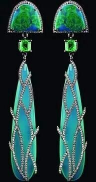 Earrings in 18k gold have 2.25 cts. t.w. colorless diamonds, turquoise, and 2.30…