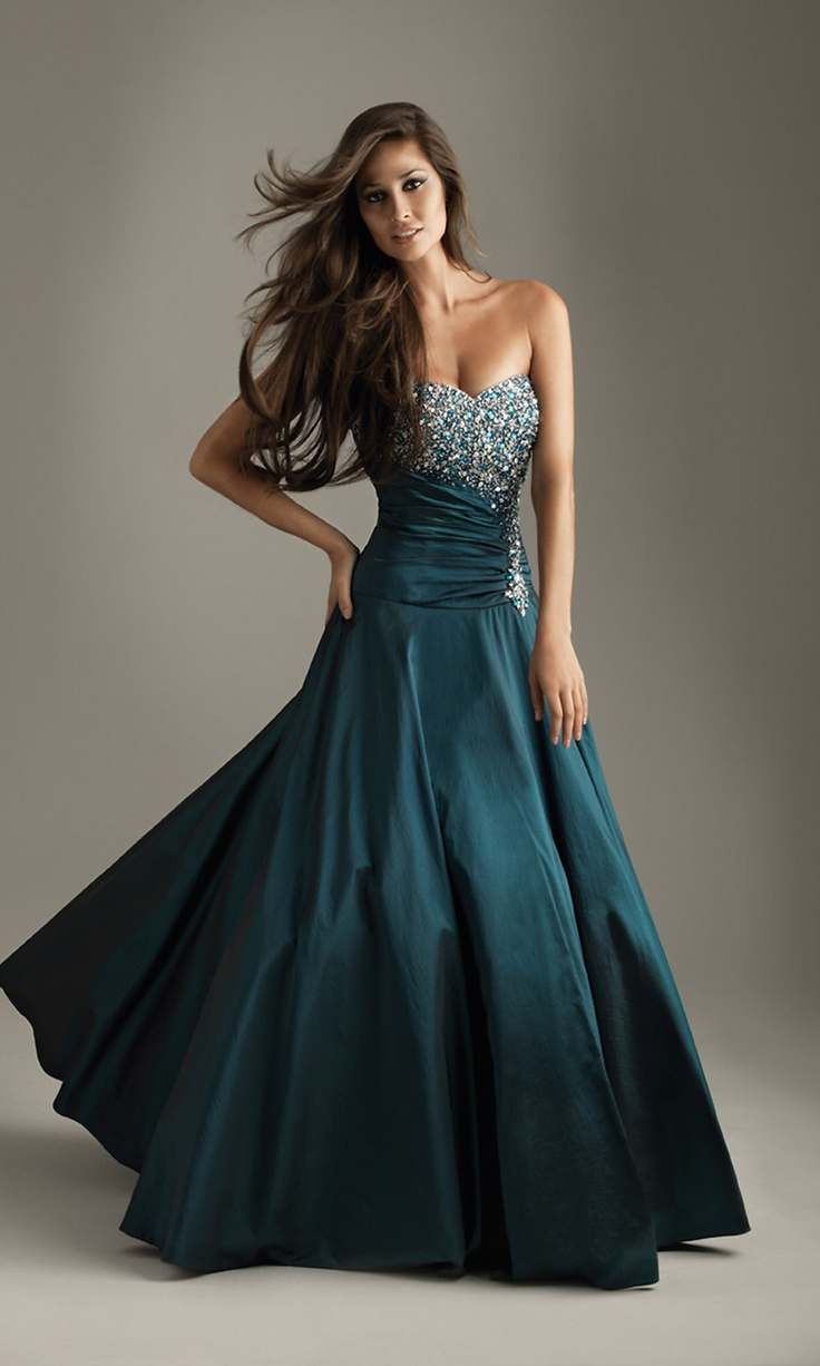This opulent ball gown is sure to make an elegant and lasting impression at your next special event. This elegant evening gown features extravagant crystal beading on the strapless sweetheart bust with a smattering of glitter running through the ruched waist. The beautiful A-line ball gown skirt glistens in rustling taffeta that's perfect for dancing at prom, pageant or special occasion party.