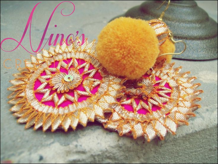 pom pom earrings by http://www.facebook.com/pages/Ninos-creations/123853704344831
