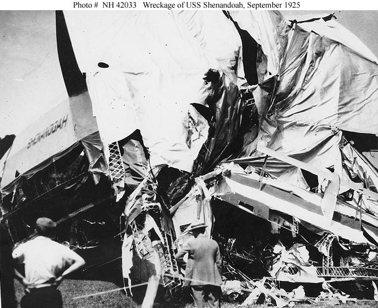 Wreckage of the airship's after section, taken soon after she crashed in southeastern Ohio.  This view shows the port side horizontal tail fin, with the airship's name just below and in front of it.  Photograph was received from the Office of Naval Intelligence, 7 November 1940.    U.S. Naval Historical Center Photograph
