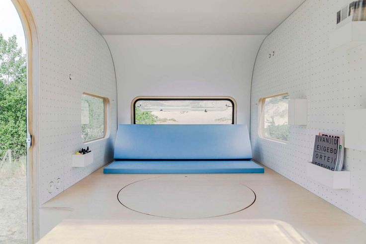 Five AM turns caravan into studio with pop-up table and pegboard walls