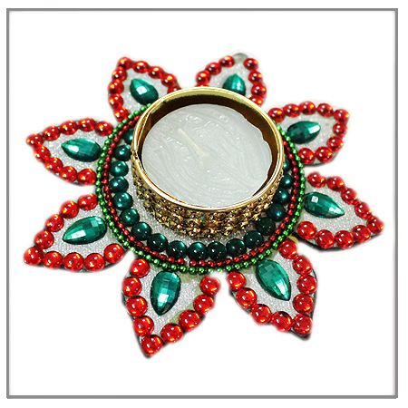 Vedicvaani.com| Handmade Flower Design Diyas Online for Sale, Flower Diya, Designer beautiful eye-catching wax diya in the shape of a Flower. Surrounded by Red and Green Stone.