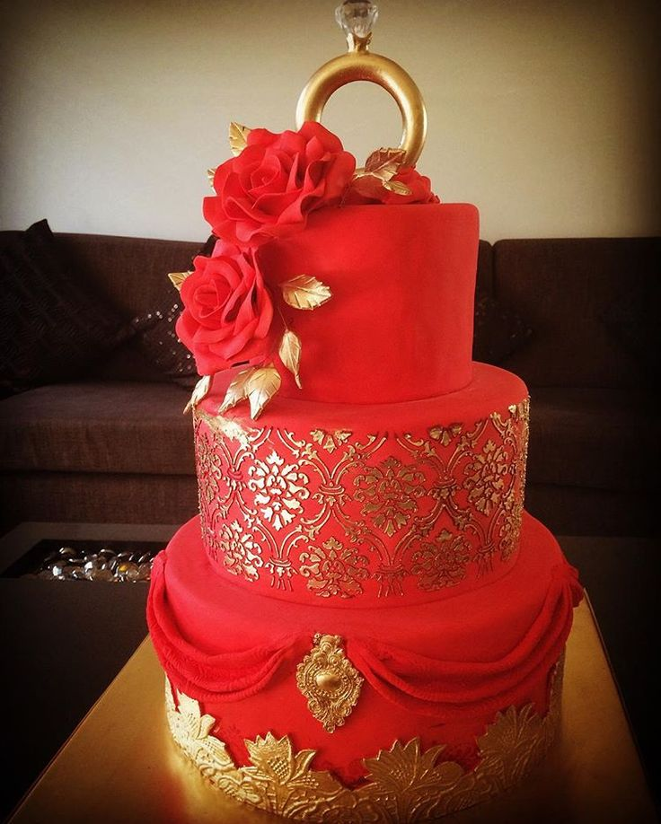 Red & Gold Engagement Cake by @thesweetboutiquedelhi  #engagementcake #red#goldcake #foodtalkindia #wedmegood #weddingsutra #designercakes #delhi #cake #cakeshop #india#delhi_secretsupperclub#engagementcakes#engagementringcake