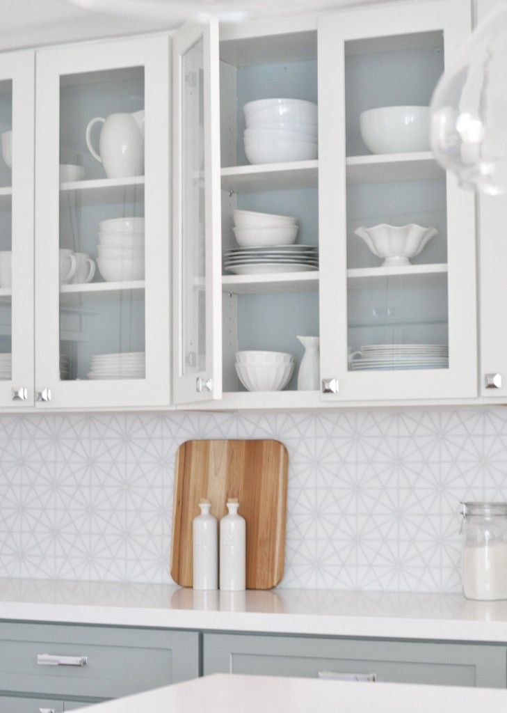 Paint the inside of upper cabinets the same color as lower cabinets to tie together