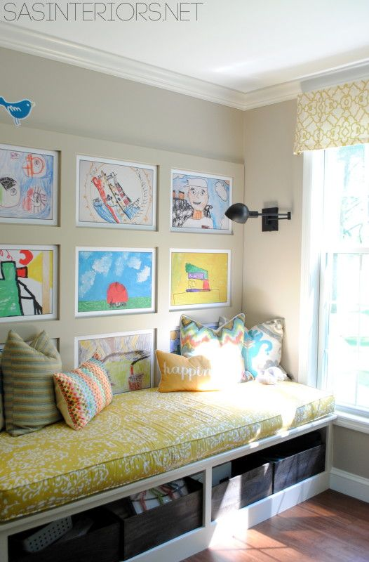 Kids' art gallery, banquette seating, under-bench storage. A cosy family nook!