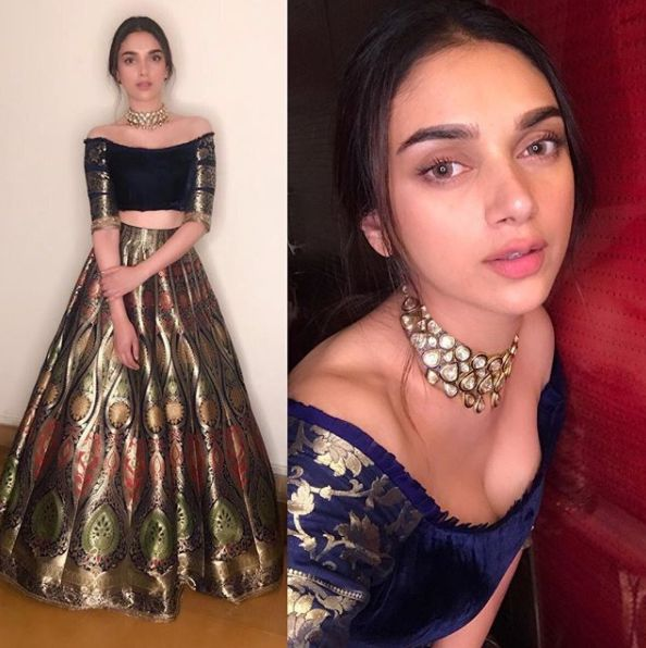 Aditi Rao Hydari in a brocade skirt paired up with a velvet off shoulder blouse with brocade sleeves by Manish Malhotra. Along with a statement choker necklace by Mahesh Notandaas.