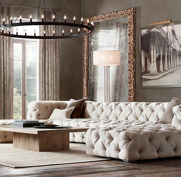 Camino Round Chandelier. Love the tufted sofa , huge floor mirror and neutral decor.