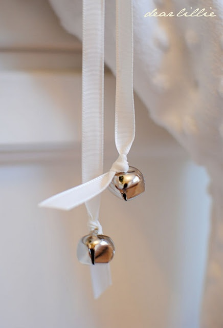tree ornament - tie jingle bell to each end of ribbon, drape over branch...