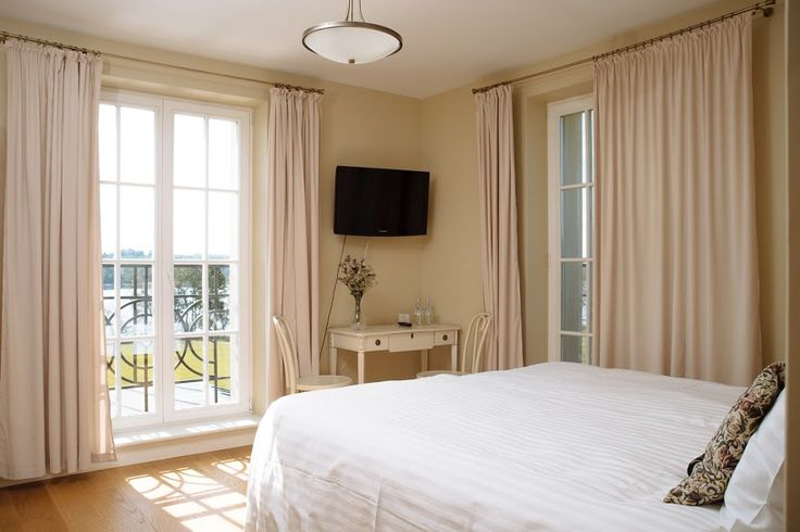 Note how the conservation casement windows enhance the interior decor of this bedroom by becoming a key focal point of the set up.