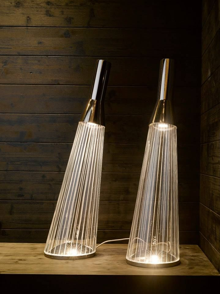 The Ray. Designed by Jakub Berdych. When illuminated, LED fibres encircling the crystal body of the Ray luminary create the look of individual light rays while also optically emitting an overal glow. #euroluce2015 #milandesignweek #salonedelmobile #design #interiordesign #designinspo #light #glass #crystal #jakubberdych #czechdesign #ray #solitairescollection #reflection #glow