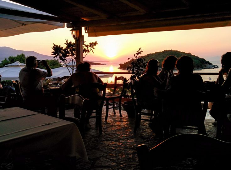 #beach #caf #chairs #men #ocean #people #restaurant #silhouette #sunrise #sunset #tables #tourists #water #women