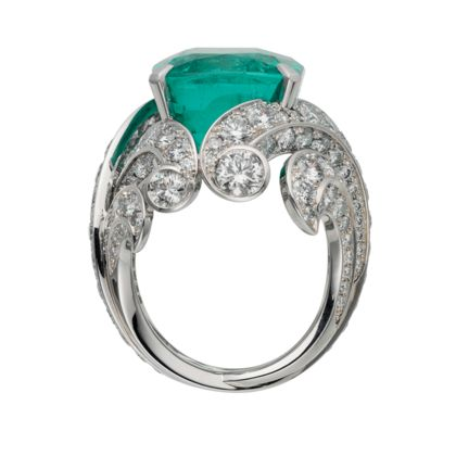 A Colombian emerald of more than 20 carats that exalts the power of plants. A majestic stone of unusual clarity mounted on a paved, interweaving structure, it evokes the natural poetry of floral decoration. Available at Cartier.