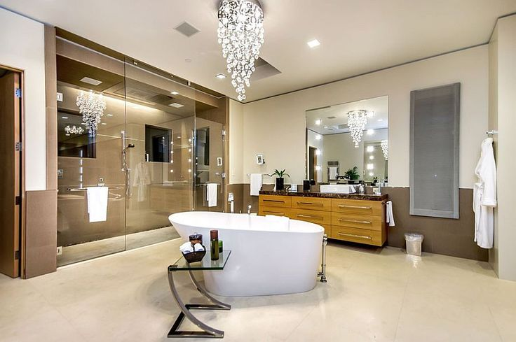 Cascading chandelier above the bathtub steals the show [Photography: Mark Pinkerton vi360]