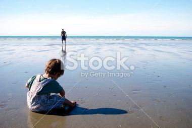 Child & Man on Beach Royalty Free Stock Photo