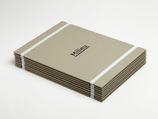 Uncoated folder with deboss logo and rubber band detail designed by Hi Ho for Melbourne-based boutique developer Milieu.