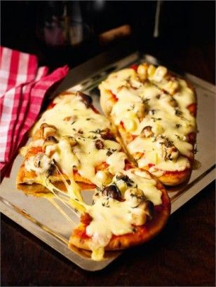 Nigella's Naan Pizza - alternatively top with tomato puree, cheese (of you choice), topping of your choice. I used mushroon, mozzarella and basil.