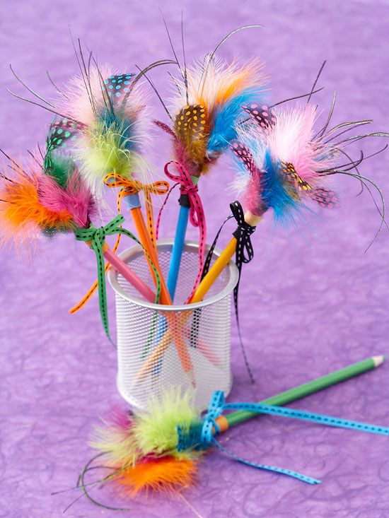 Feather Pencil toppers make homework and coloring fun! Attach feathers to the top of each pencil by wrapping them with florist's tape. Add a bow for more pizzazz.