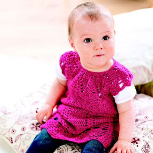 Bethan by Ruth Maddock is a vibrant summer dress that's great for tiny tots Here at LK we love to see babies wearing bright and beautiful colours and this bold pink is just full of joy. This little dress features gorgeous lace detailing on the yoke and hem, and a more straightforward eyelet treble pattern for the body. The lace pattern requires a lot of concentration so this dress is best suited to those of you at an intermediate level of crochet.