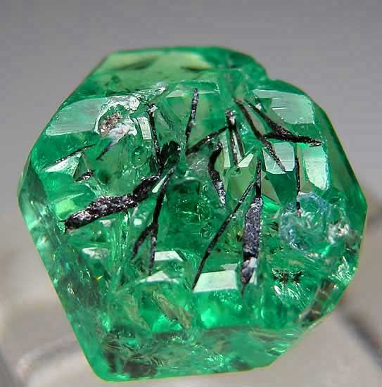 Tsavorite with inclusions of ??