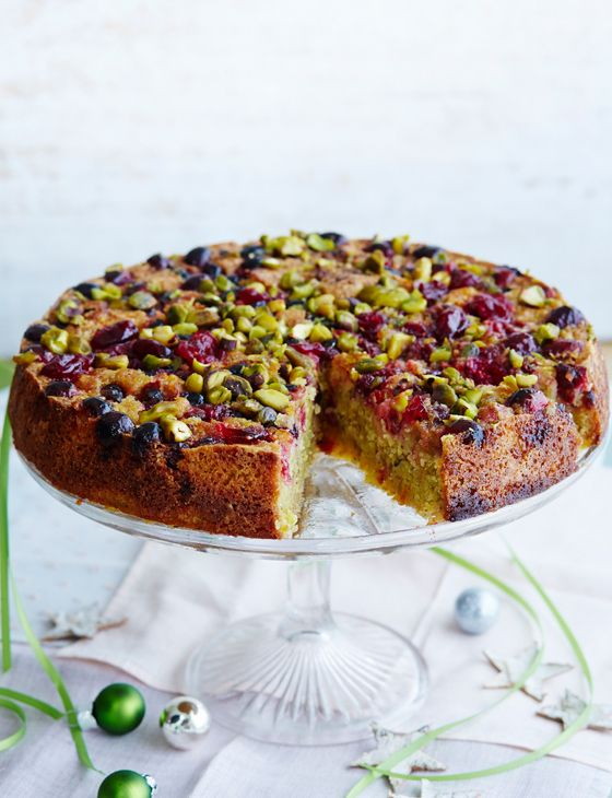 Serve this spiced pistachio and almond cake with cranberries warm with ice cream for a classy pudding.