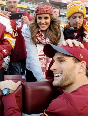 Washington Redskins quarterback Kirk Cousins talks to his wife, Julie, before a playoff game against... - Brad Mills/USA TODAY Sports