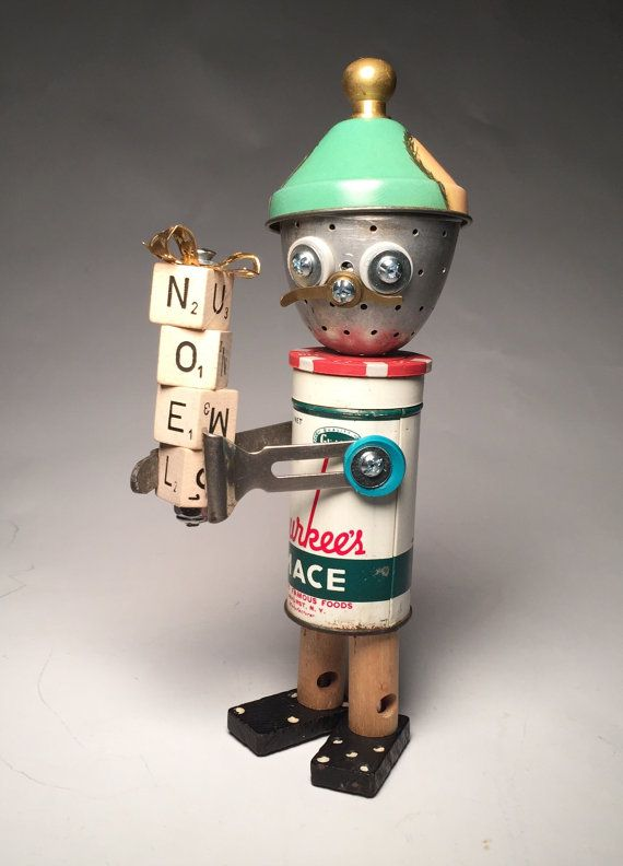 Heres wishing you a Merry Kitsch-Mace! Its an assemblage art elf sculpture I made from recycled materials including: • Vintage Spice Tin • Tea