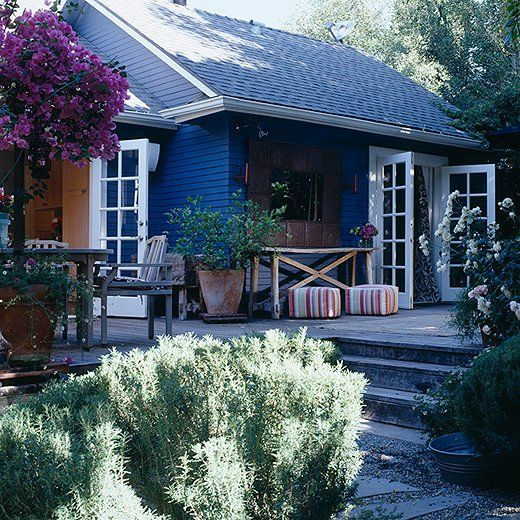 Dark blue home exterior with white window trim, painted with Ralph Lauren home paint.