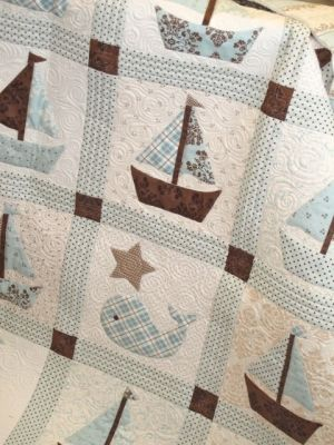 Love the sailboats on this one using the different patterns. Use this sailboat on the teal and navy whale quilt.