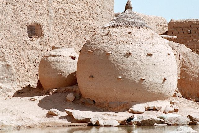 Africa   Granaries in Ayorou along the Niger River. These round adobe structures serve for storing grains, primarily millet and sorghum..  Tillaberi, West Niger.   ©Irena Bozin