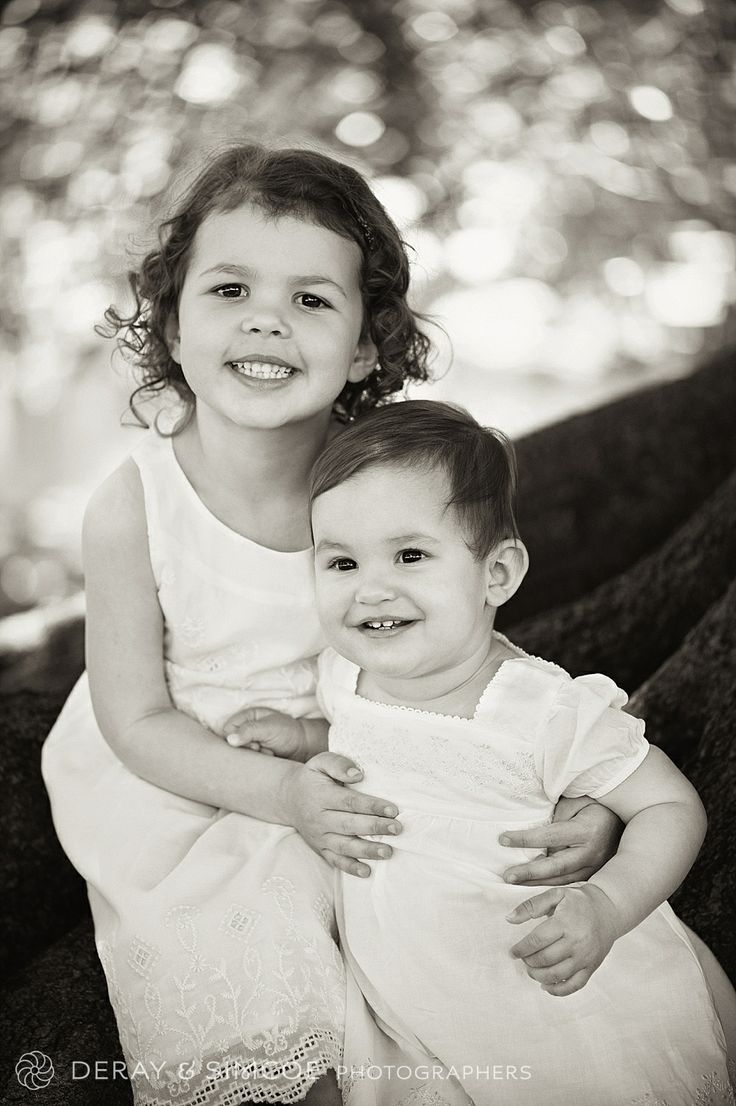 White is always a good choice. Timeless, fresh and simple on little girls. Photography by DeRay & Simcoe
