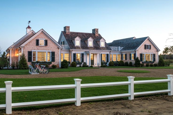 Our #pintour starts with the front yard. With its Cape Cod-style architecture, lush landscaping, and charming window boxes, this classic New England-style curb appeal offers timeless style and a gracious welcome. #HGTVDreamHome